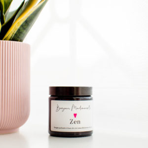 Zen Candle from Bonjour Mademoiselle sitting beside a pale pink plant pot
