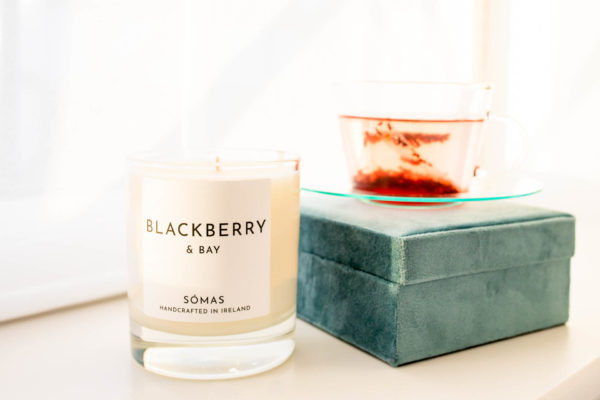 Blackberry and Bay candle sitting beside a green jewellery box