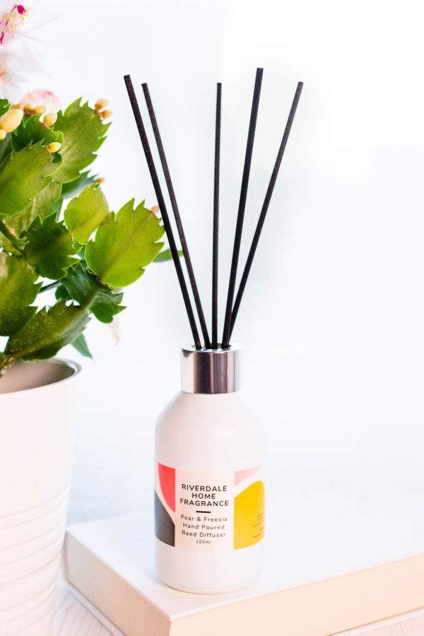 Pear and Freesia Diffuser with a plant beside