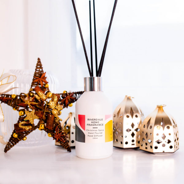 Christmas Spice Reed Diffuser beside Christmas decoration