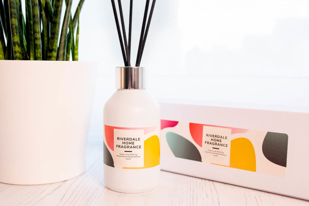 Cassis and Wild Fig Diffuser with gift box. Sitting beside a pot plant