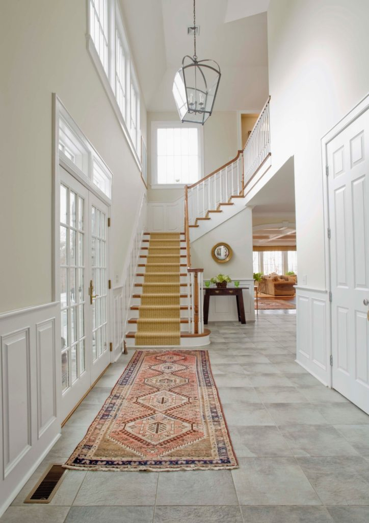 light and bright hallway with vintage rug and stair runner