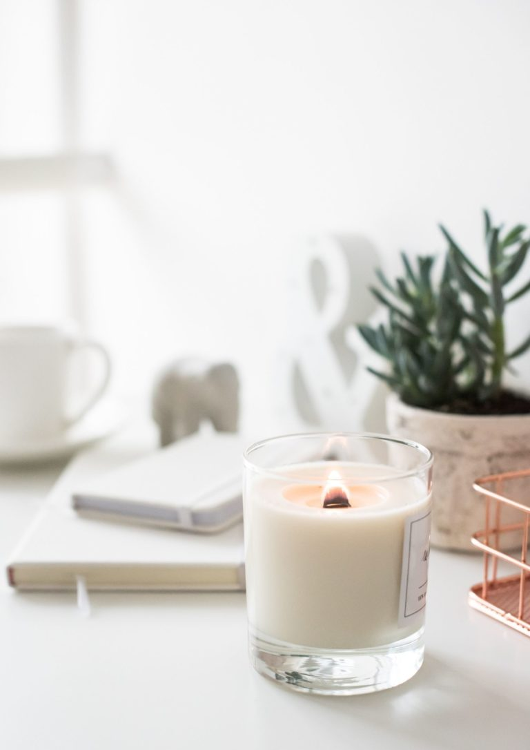 Flickering candle beside a pot plant