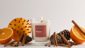 Image of Winter candle surrounded by orange slices, clove and cinnamon.